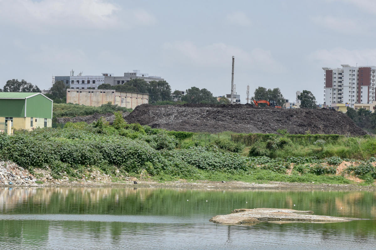 Refuse-derived Fuel (RDF) accumulated on the Somasundara Palya lakebed has been emitting fumes for the past two weeks. DH PHOTO/S K DINESH