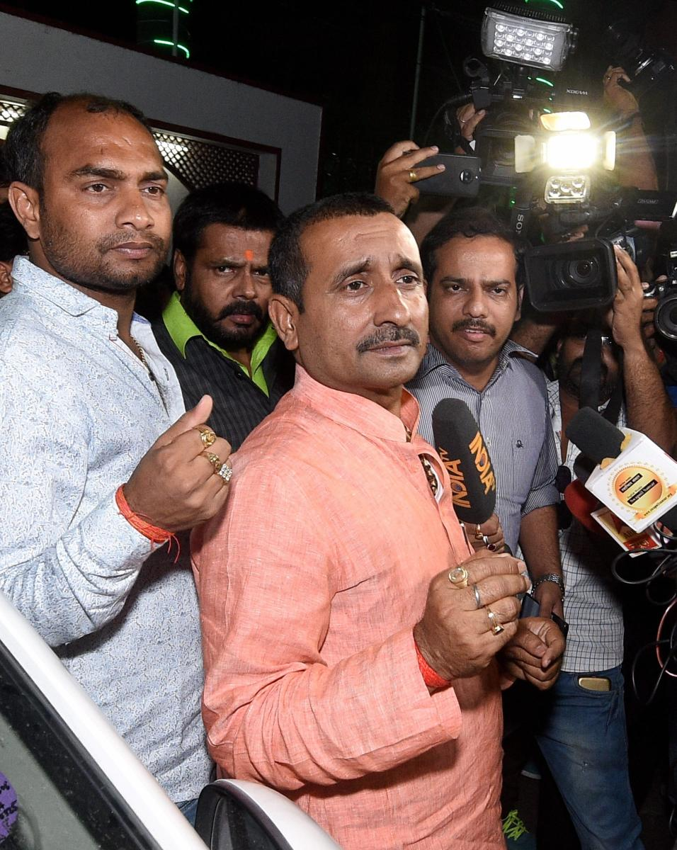 BJP MLA from Unnao Kuldip Singh Sengar, accused in a rape case, outside the office of the Senior Superintendent of Police in Lucknow on Wednesday night. (PTI Photo)