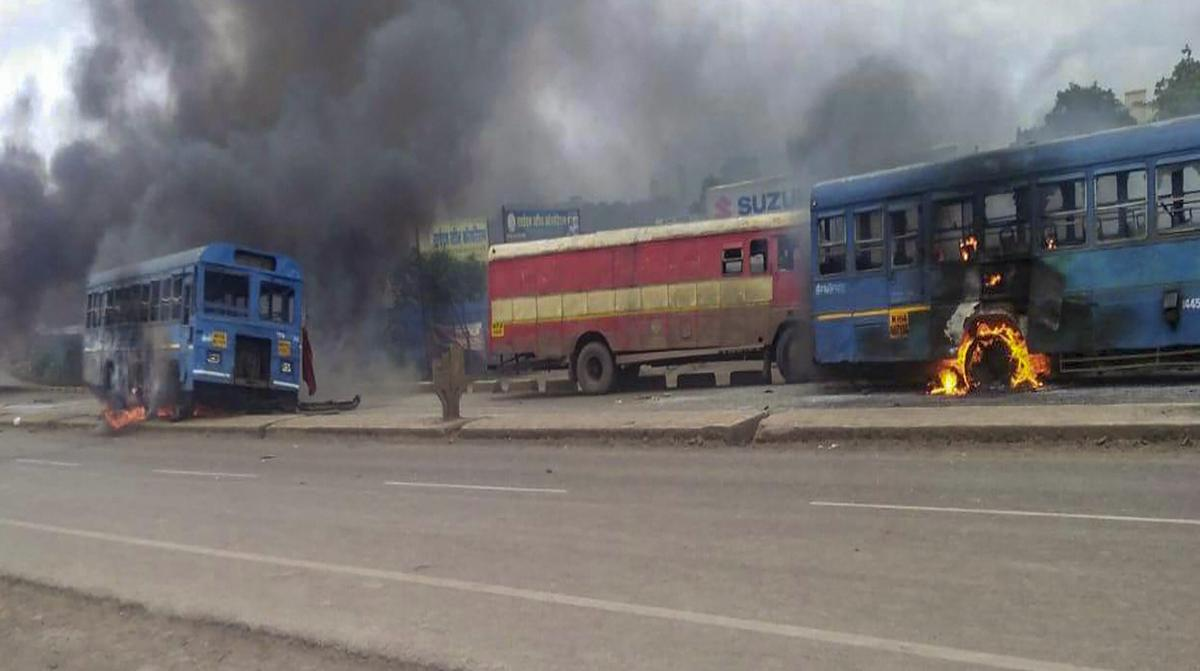 Maratha Kranti Morcha activists set ablaze buses during their district bandh called for reservations in jobs and education, in Solapur, Maharashtra on Monday, July 30, 2018. (PTI Photo)