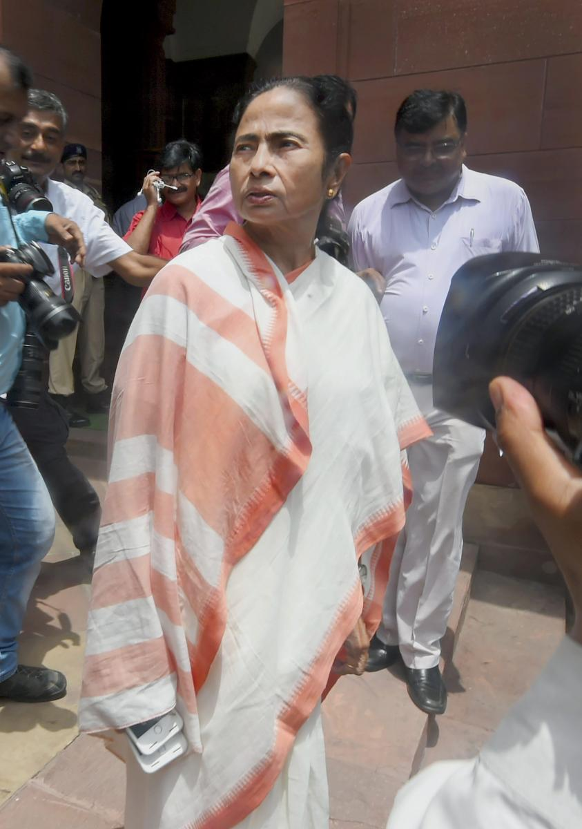 West Bengal Chief Minister Mamata Banerjee arrives at Parliament House, in New Delhi on Wednesday. (PTI Photo)