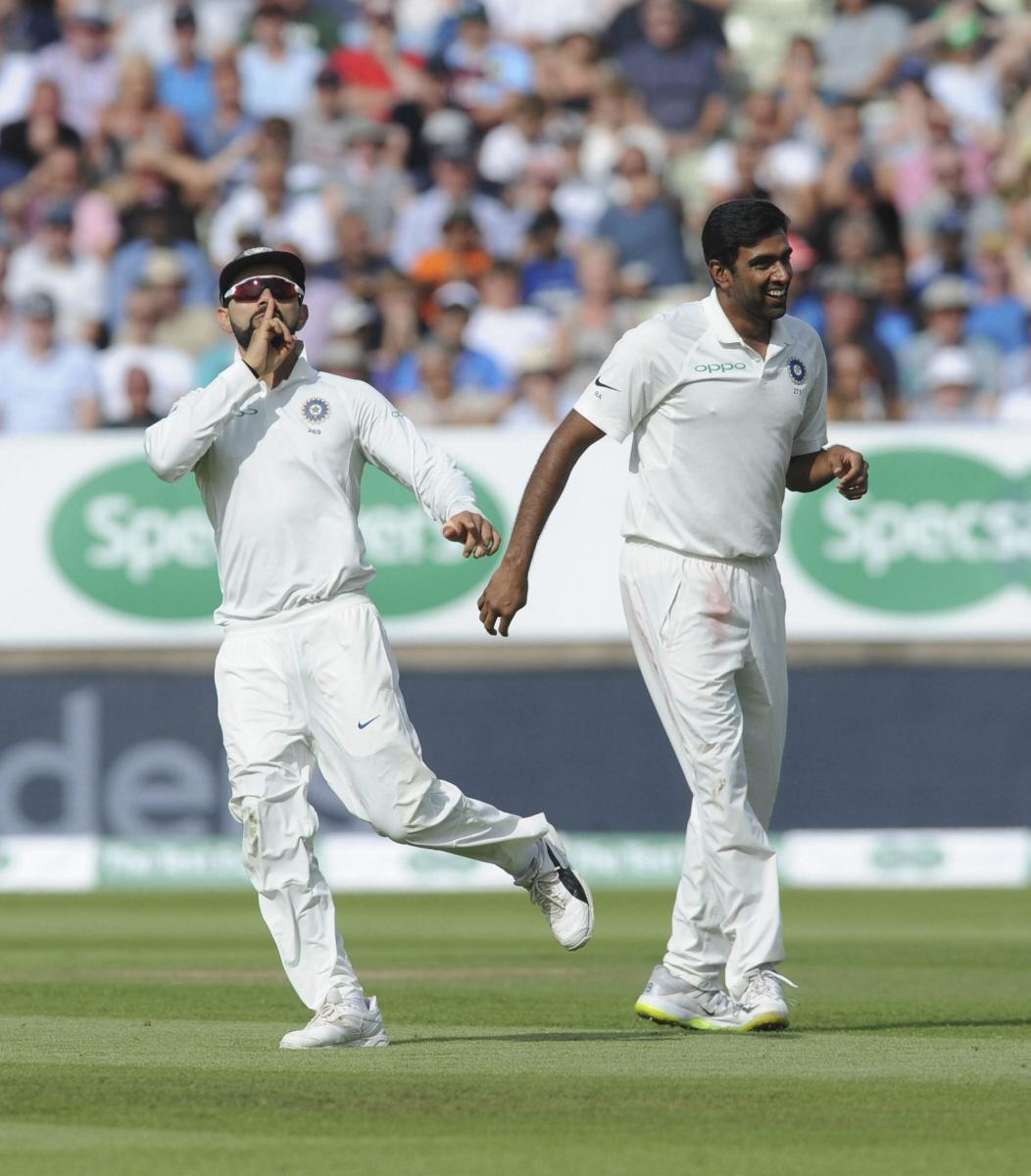 SILENCING THE OPPONENTS: Indian skipper Virat Kohli (left) celebrates with R Ashwin after dismissing England captain Joe Root with a superb direct hit. AP/PTI