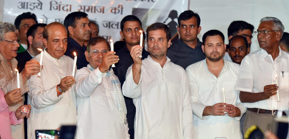 (L-R) CPI (M) leader Sitaram Yechury, TMC leader Dinesh Trivedi, Loktantrik Janata Dal leader Sharad Yadav, Congress President Rahul Gandhi, CPI leader D Raja and others during a protest over the issue of alleged sexual abuse at a government-funded shelte