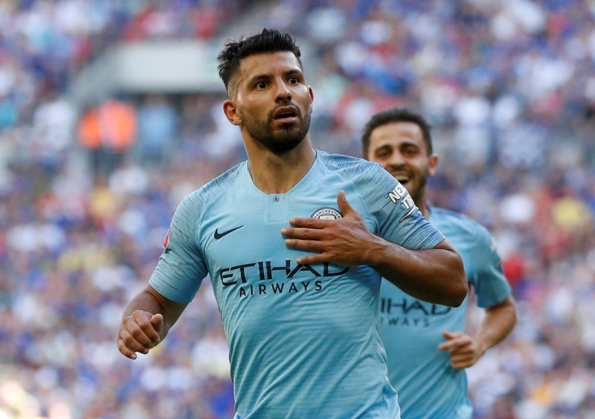 Ruthless: Manchester City's Sergio Aguero celebrates after scoring their second goal against Chelsea on Sunday. Reuters