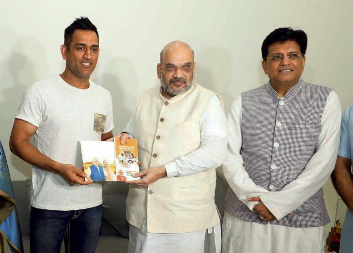 BJP President Amit Shah meets Indian cricketer M S Dhoni during his 'Sampark for Samarthan' campaign to generate awareness about the NDA government's achievements, in New Delhi on Sunday. PTI photo