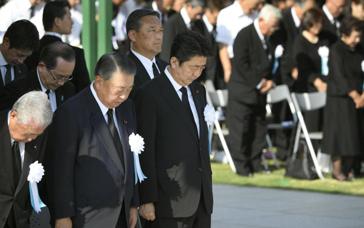 Japan's Prime Minister Shinzo Abe and other officials offer a silent prayers for the victims of the 1945 atomic bombing, at Peace Memorial Park in Hiroshima, western Japan, August 6, 2018, on the 73rd anniversary of the atomic bombing of the city. (Kyodo/
