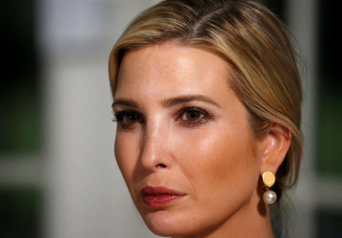 White House Senior Advisor Ivanka Trump listens as her father U.S. President Donald Trump speaks at a dinner with business leaders at Trump National Golf Club in Bedminster, New Jersey, U.S., August 7, 2018. REUTERS/Leah Millis