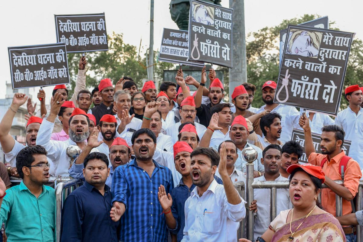 Samajwadi Party activists display placards and raise slogans against Uttar Pradesh Chief Minister Yogi Adityanath during a protest over the recent Deoria shelter home incident, in Allahabad. PTI photo