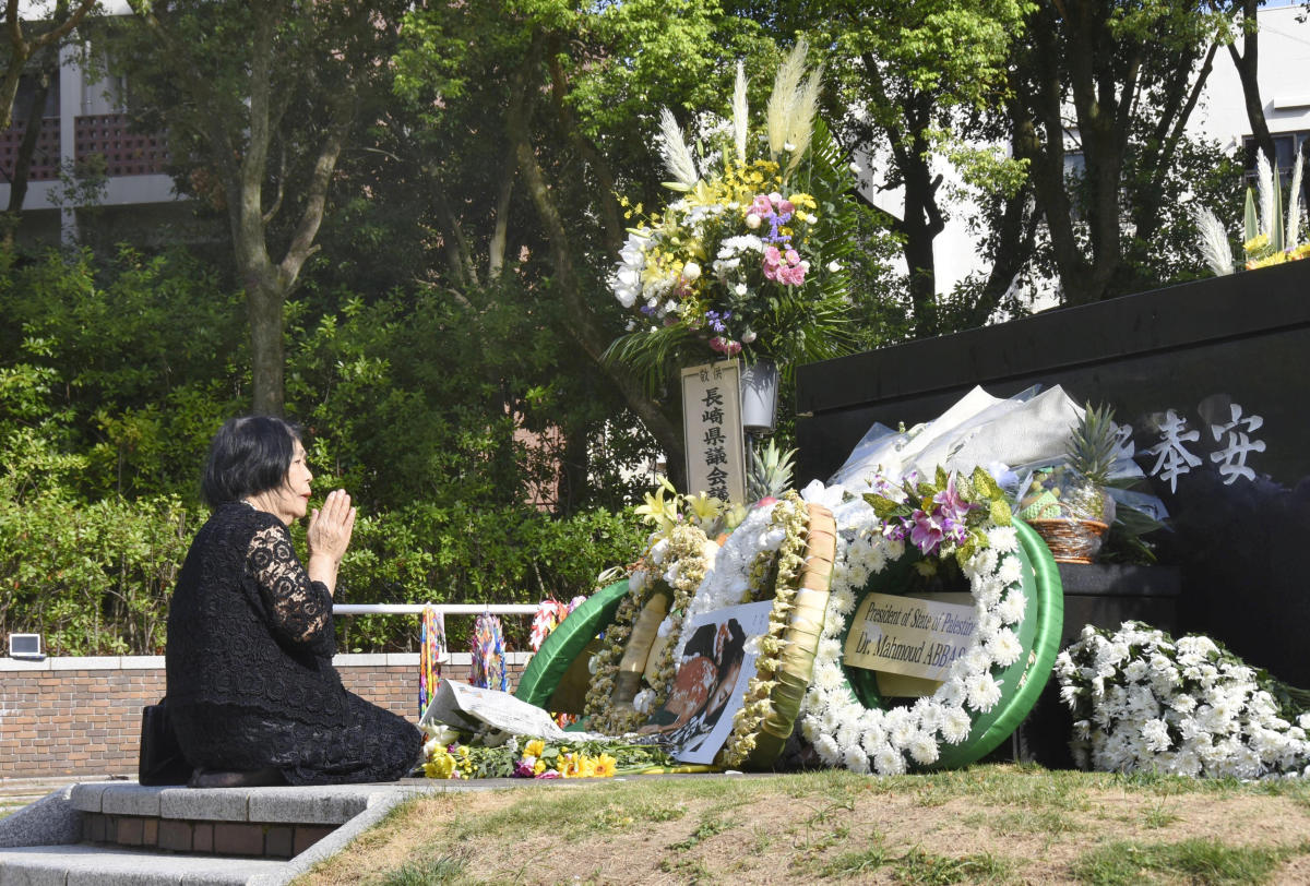 A woman prays for victims of the 1945 atomic bombing on a day commemorating the 73rd anniversary of the bombing at Nagasaki's Peace Park, western Japan, in this photo taken by Kyodo August 9, 2018. (Kyodo/via REUTERS)