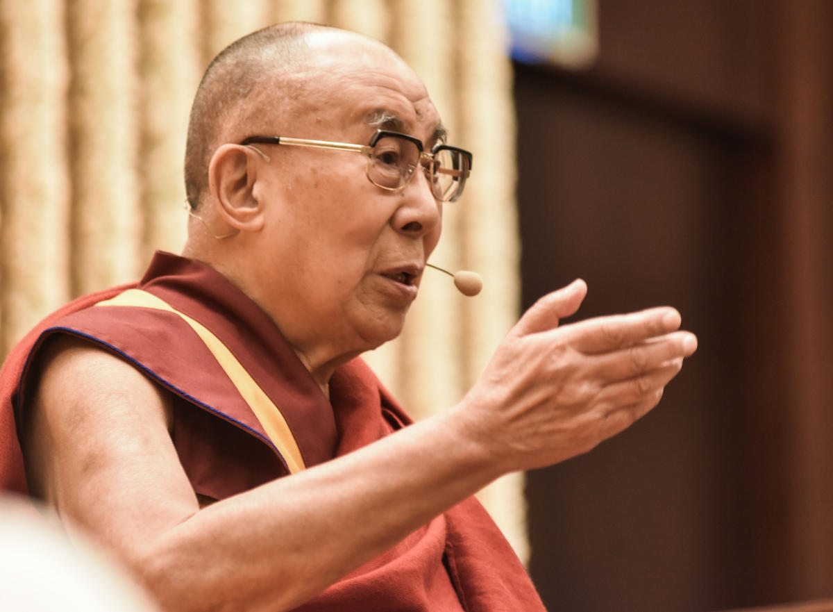 The 14th Dalai Lama speaks at a talk on 'Courage and Compassion in the 21st century', in Bengaluru on Saturday. (DH Photo/S K Dinesh)
