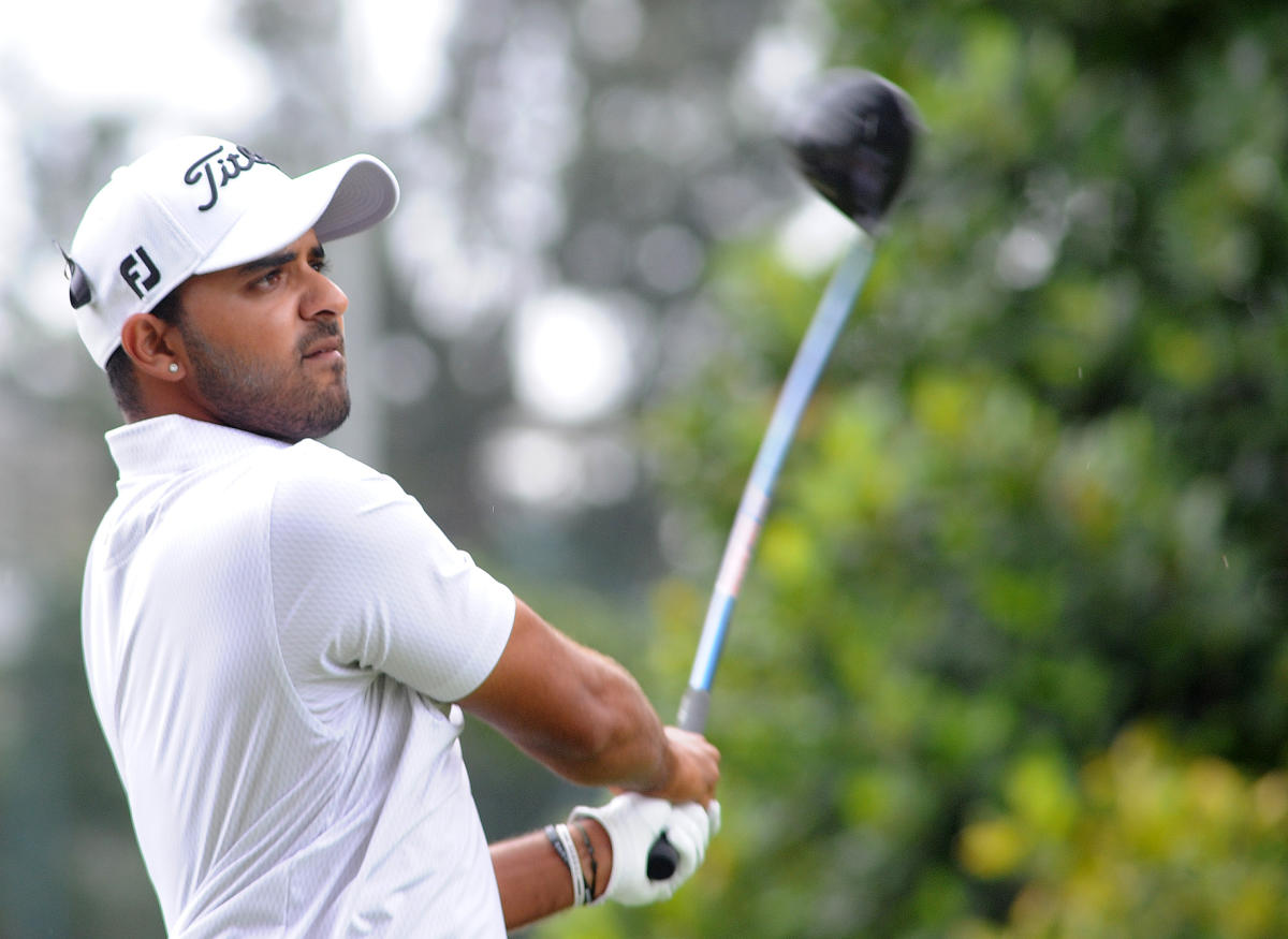 Fine Rally: India's Khalin Joshi in action on the third day of the Take Solutions Masters Golf tournament at the KGA course on Saturday. DH Photo/ Srikanta Sharma R