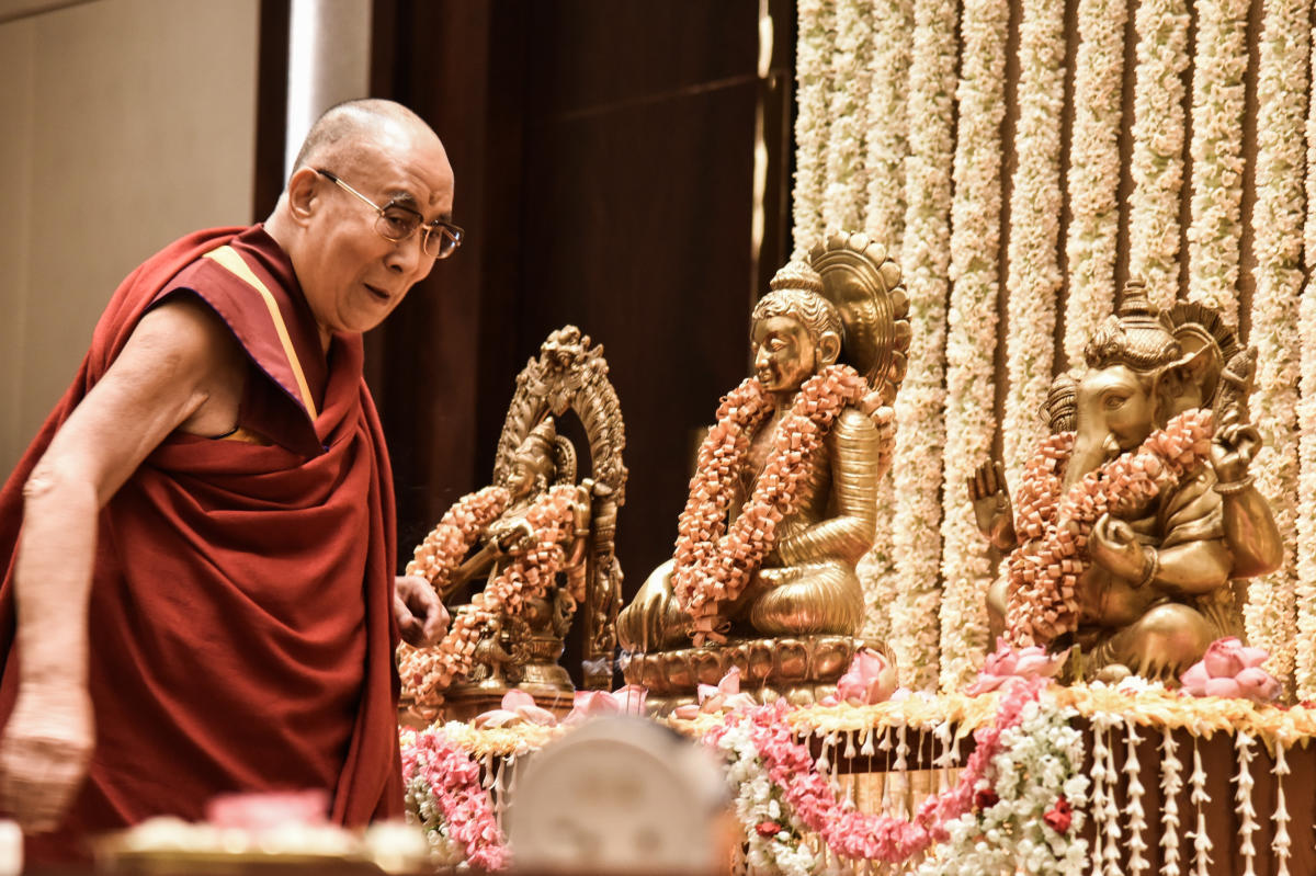 The 14th Dalai Lama offers prayer at a programme in Bengaluru on Saturday. DH Photo