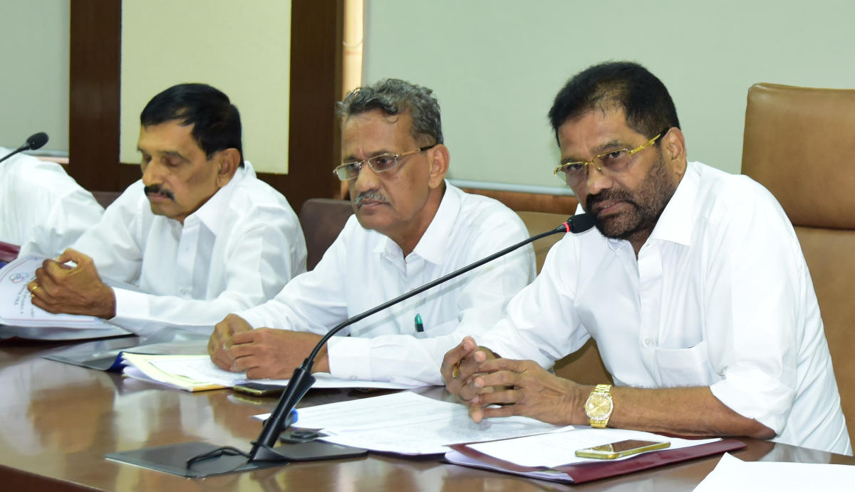 SCDCC Bank Chairman M N Rajendra Kumar speaks to media persons.