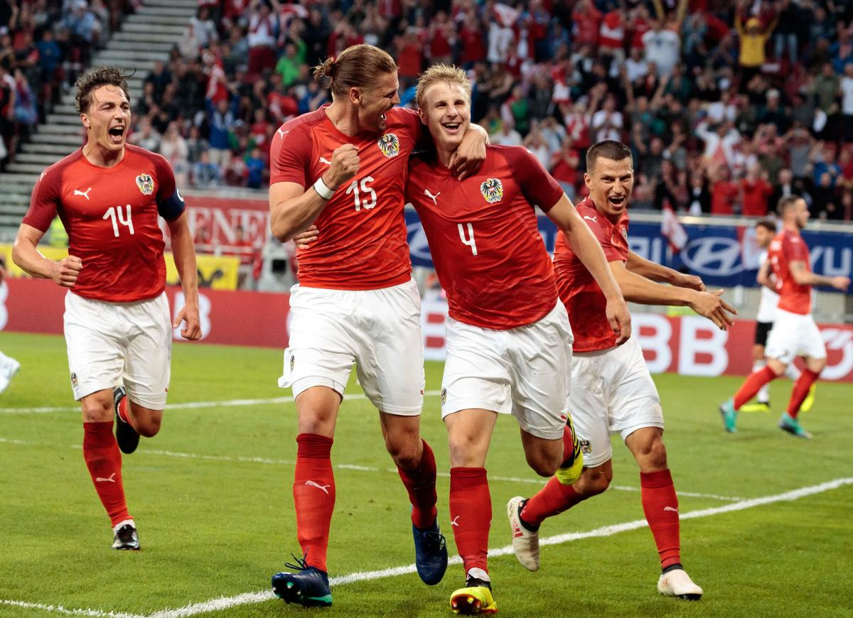 Austria's Martin Hinteregger (right) celebrates with team-mates after scoring against Germany in an international friendly match on Saturday. AFP