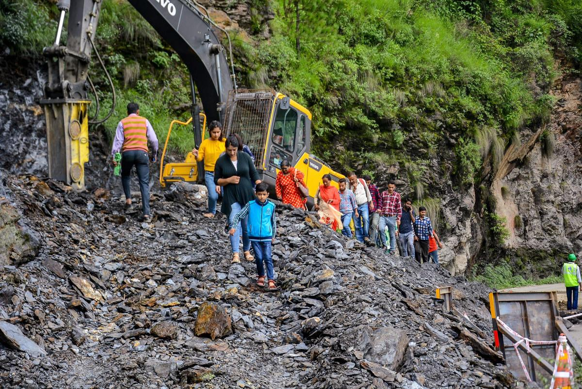 Restoration works underway after a major landslide on the national highway near Malyana due to heavy rains, in Shimla on Saturday, Aug 11, 2018. (PTI Photo)