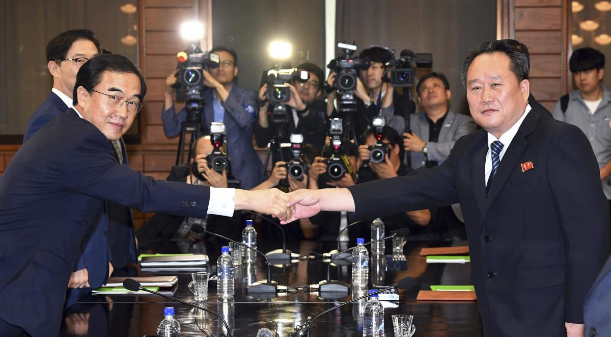 South Korean Unification Minister Cho Myoung-gyon, left, shakes hands with his North Korean counterpart Ri Son Gwon during their meeting at the northern side of Panmunjom in the Demilitarized Zone, North Korea, Aug. 13, 2018. (AP/PTI)