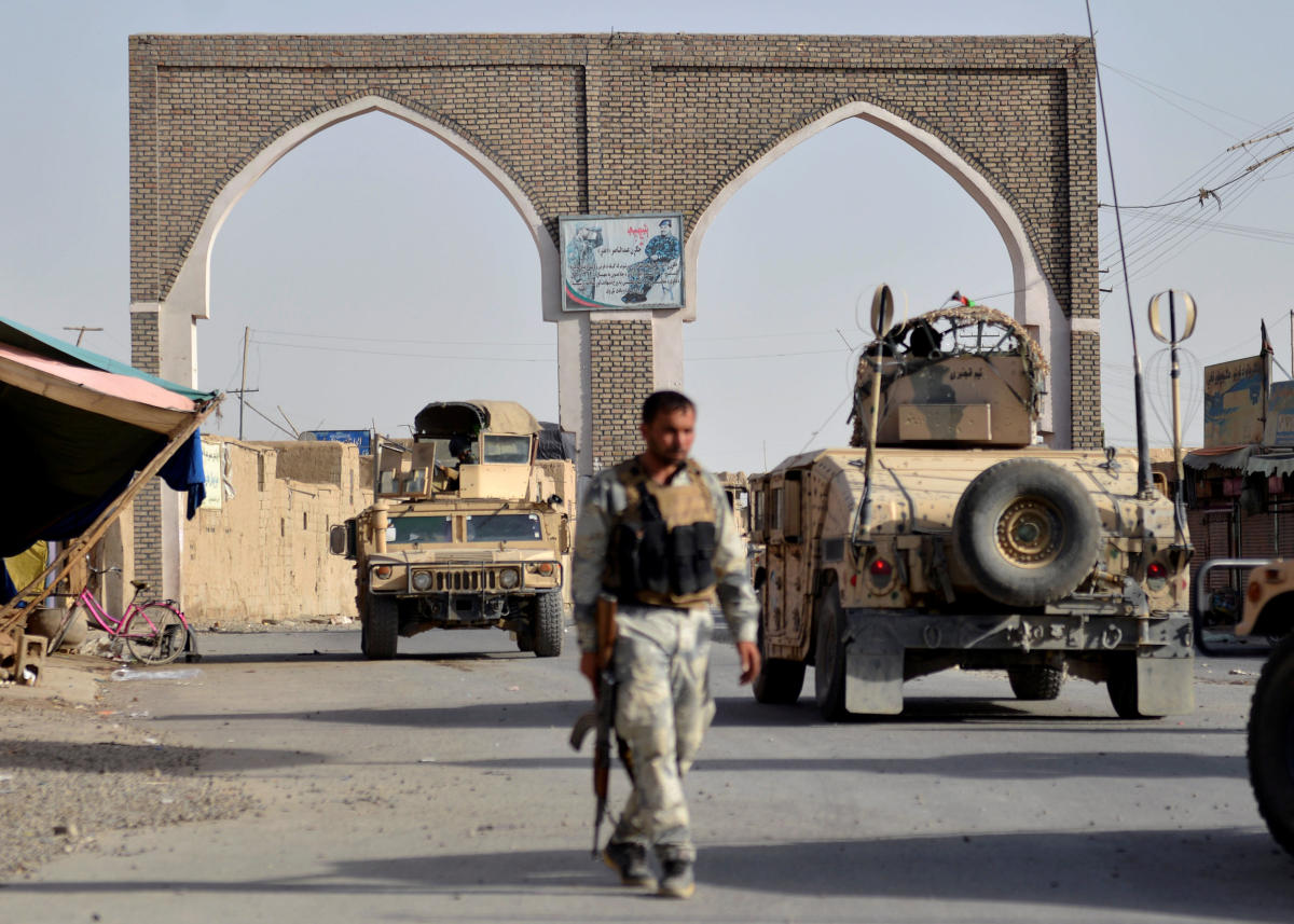 An Afghan security guard walks during a Taliban attack in Ghazni city, Afghanistan August 12, 2018. REUTERS