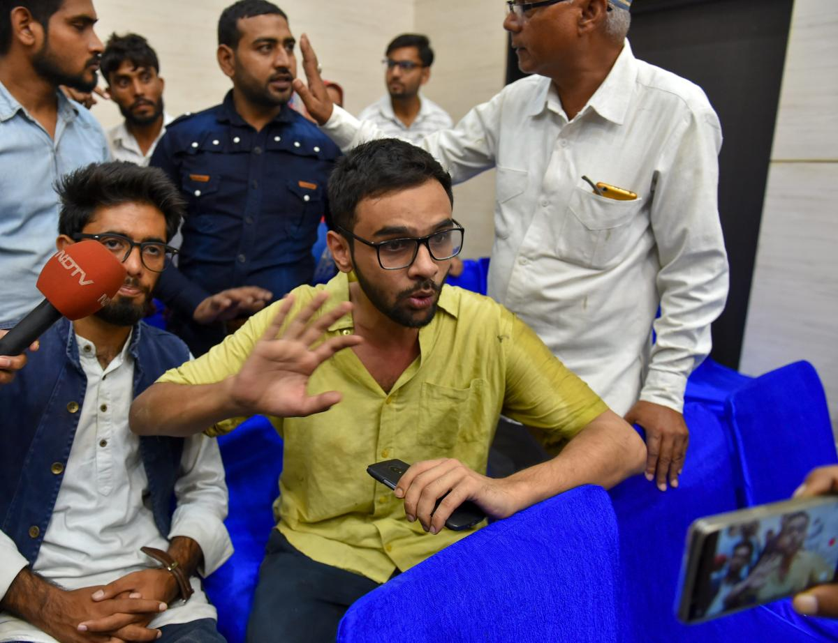 Jawaharlal Nehru University (JNU) student Umar Khalid speaks to the media moments after he was shot at, during an event at the Constitution Club in New Delhi on Monday. PTI Photo
