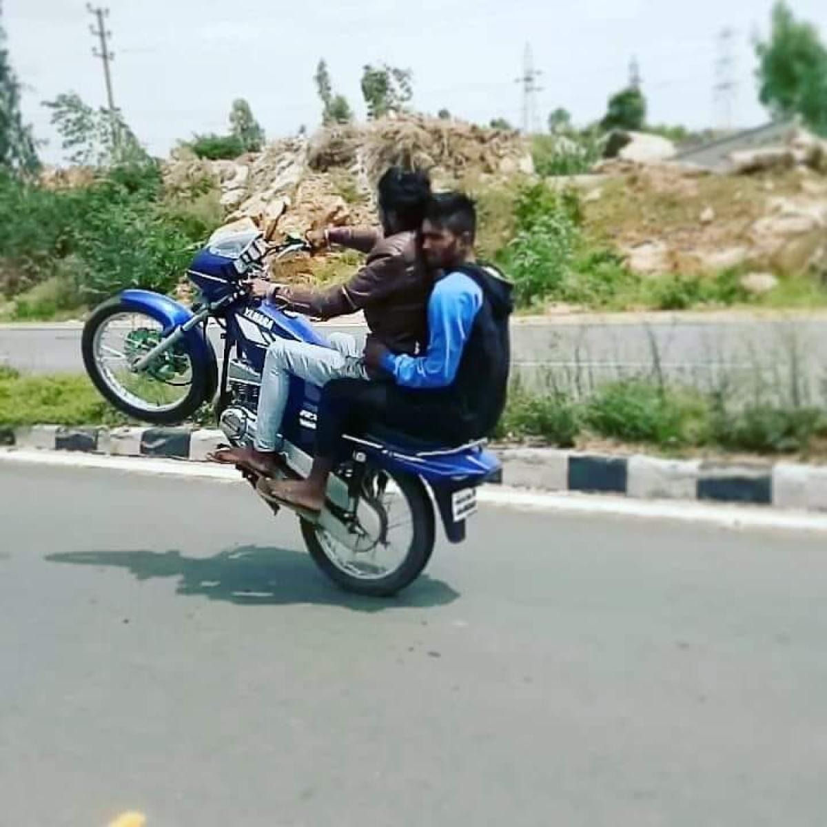 A rider doing a wheelie, as captured by his friend and posted on social media. POLICE HANDOUT