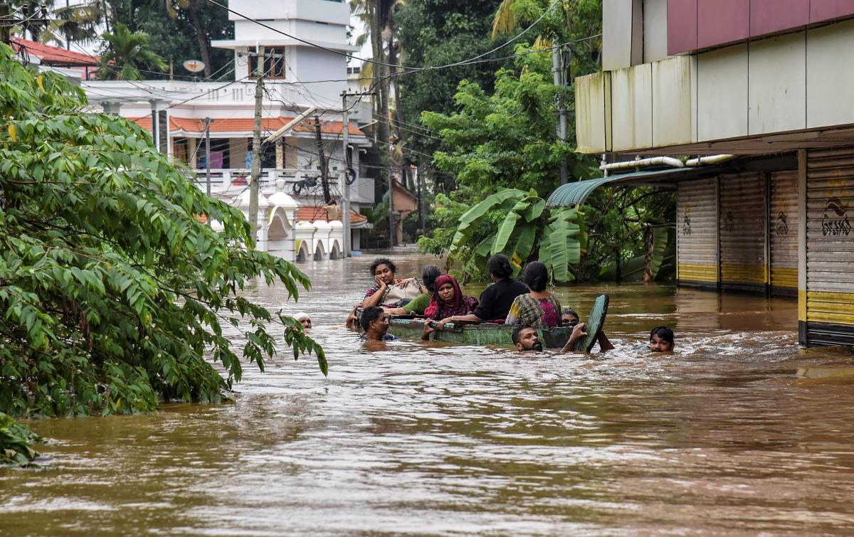 People being rescued from a flood-affected region following heavy monsoon rainfall, in Kochi on Thursday. PTI