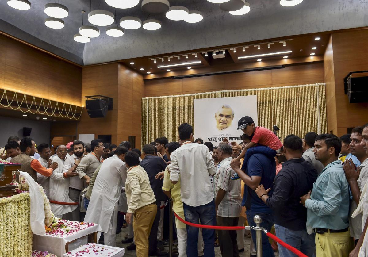 People pay their last respects to the mortal remains of former prime minister Atal Bihari Vajpayee at the BJP headquarters at DDU Marg in New Delhi on Friday, August 17, 2018. A seven-day state mourning has been announced as a mark of respect for the former prime minister Vajpayee who passed away at the age of 93, at Delhi's AIIMS hospital on Thursday. (PTI Photo)