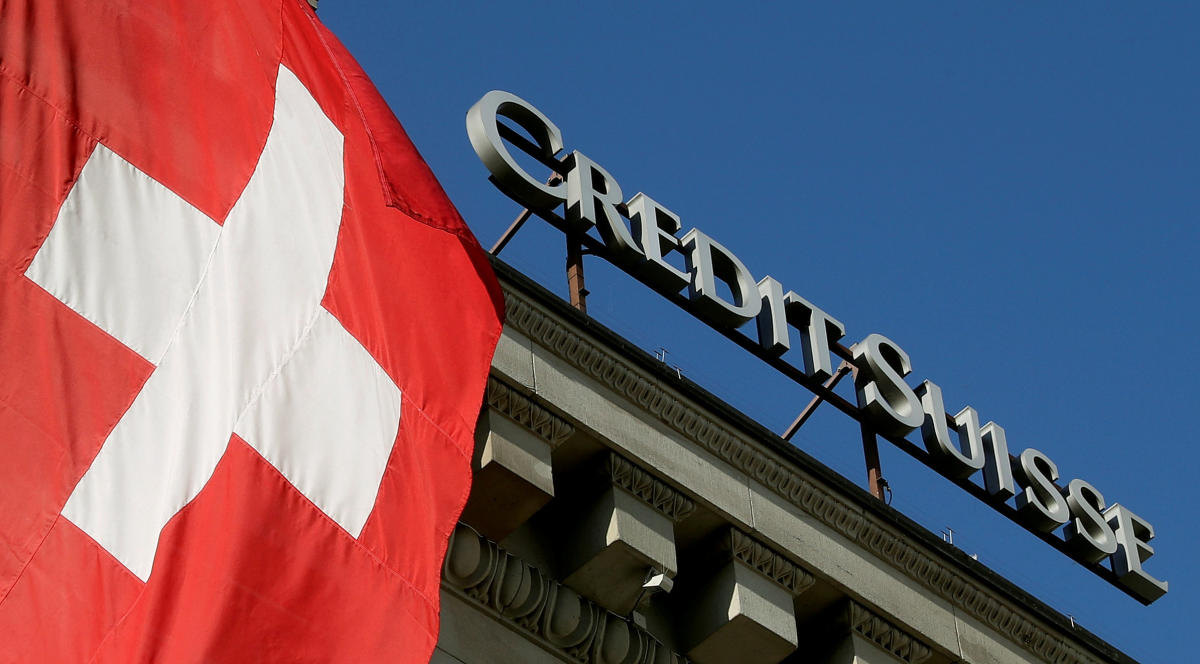 Switzerland's national flag flies next to the logo of Swiss bank Credit Suisse at a branch office in Luzern, Switzerland on October 19, 2017. Reuters