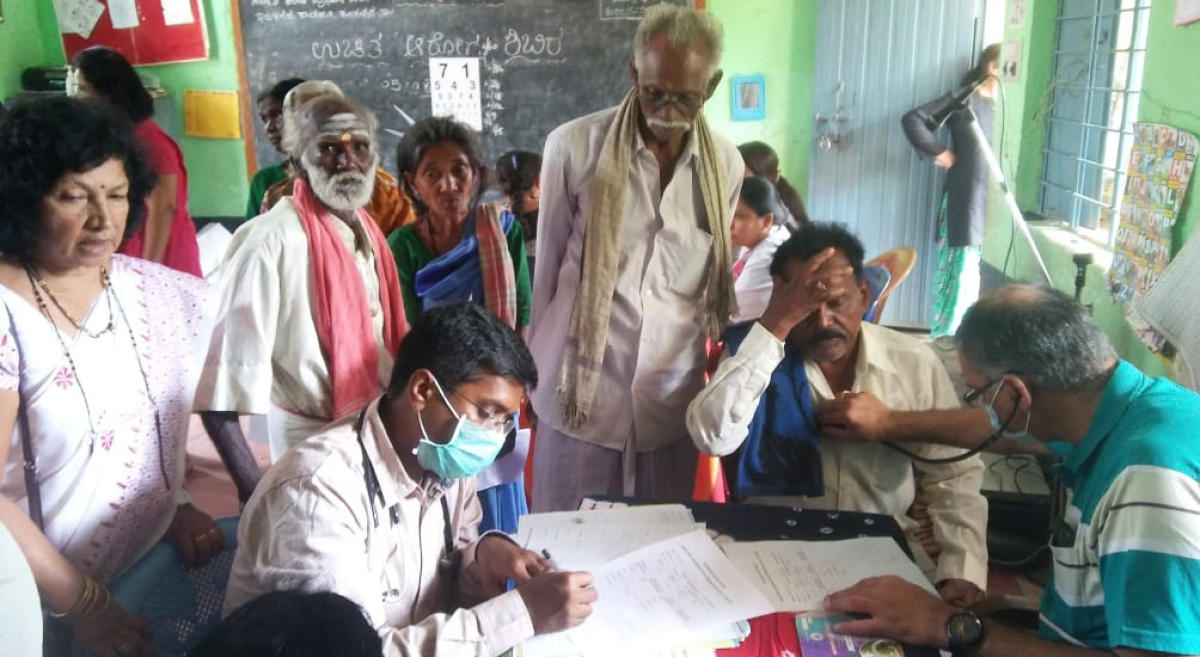 Tribals undergo the health check-up camp in Iruligara Colony. Paranjyothi (in white sari) who organised the camp.