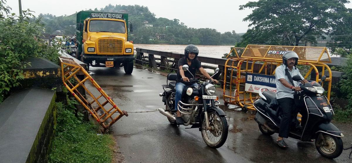 Heavy vehicles ply on Panemangaluru Old Bridge.