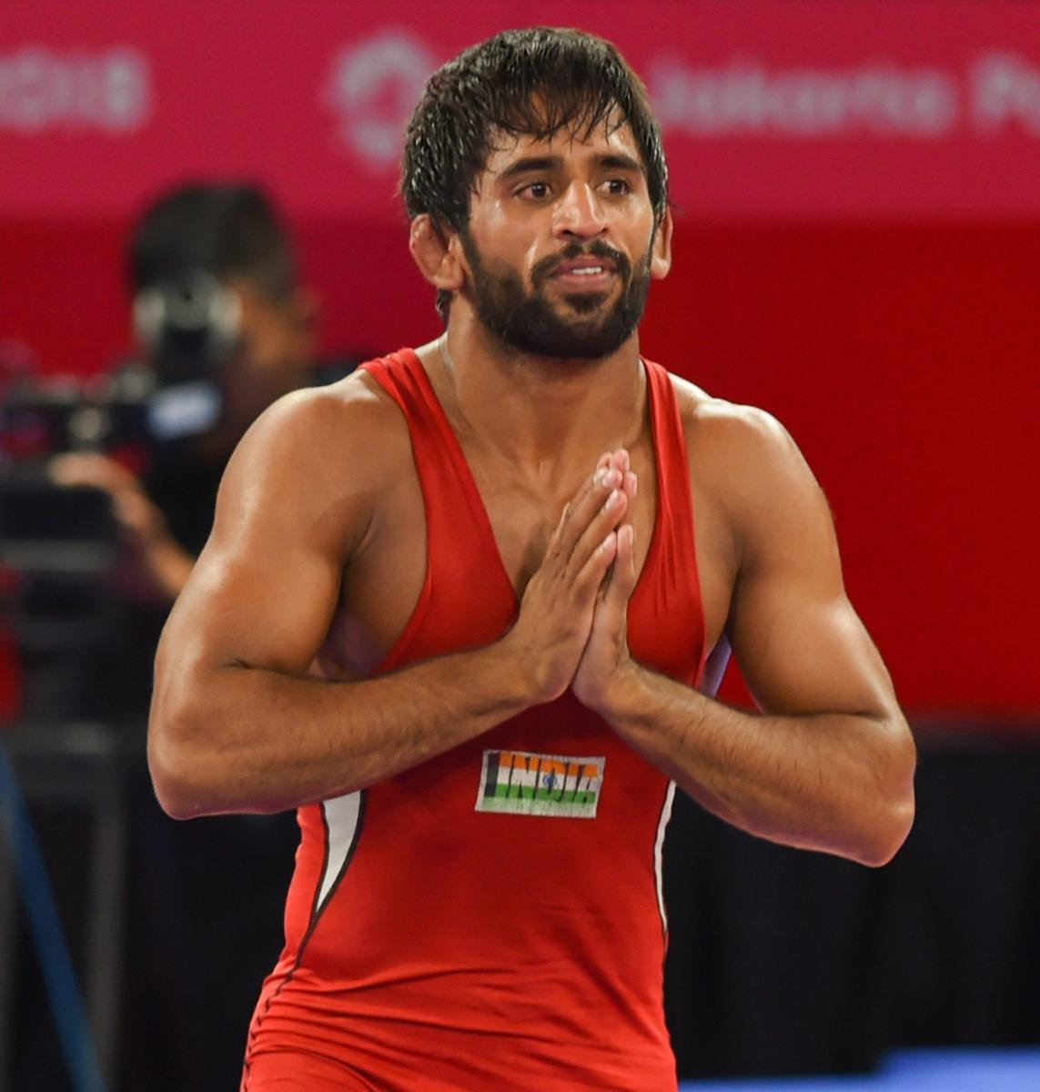 Bajrang, who came into the Asian Games as favourite to win the gold in this category, beat his Japanese opponent 11-8 in the final bout. PTI Photo