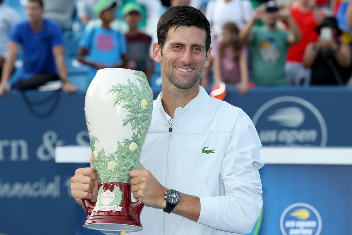 FINALLY! Novak Djokovic of Serbia poses with the trophy after defeating Roger Federer of Switzerland in the Cincinnati Masters final. AFP