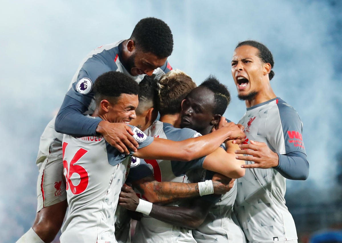 VITAL STRIKE Liverpool's Sadio Mane (second from right) celebrates with team-mates after scoring his side's second goal. REUTERS