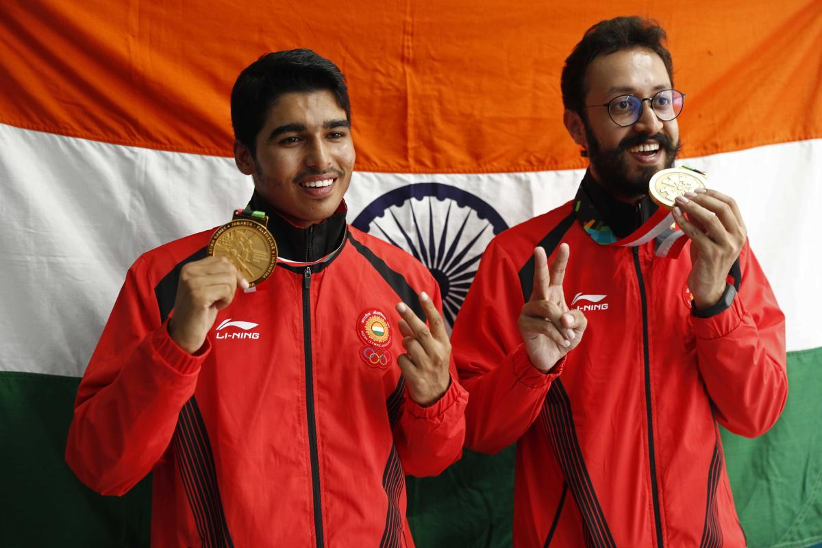 A RARE DOUBLE: Gold medallist Saurabh Chaudhary (left) and bronze medallist Abhishek Verma display their spoils in Palembang on Tuesday. BOTTOM: Veteran Sanjeev Rajput won silver in the 50M rifle event. REUTERS/PTI
