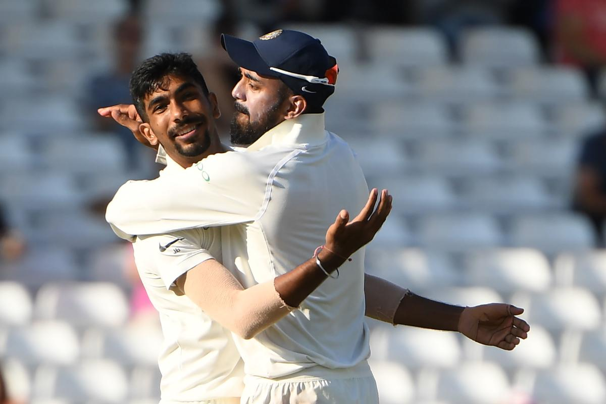 On FIRE: India's Jasprit Bumrah (left) celebrates with K L Rahul after dismissing England's Jos Buttler on Tuesday. AFP