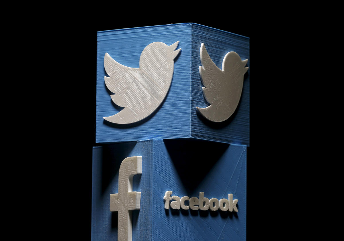 Facebook Inc, Twitter Inc and Alphabet Inc collectively removed hundreds of accounts tied to an alleged Iranian propaganda operation on Tuesday, while Facebook took down a second campaign it said was linked to Russia.