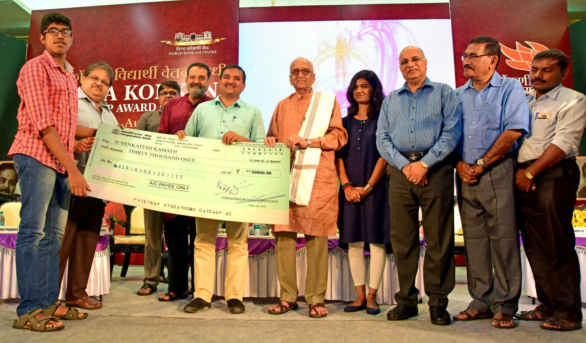 Engineering student N Venkatesh Kamath receives scholarship, instituted by Vishwa Konkani Student Scholarship Fund (VKSSF), at a programme in Mangaluru on Friday.