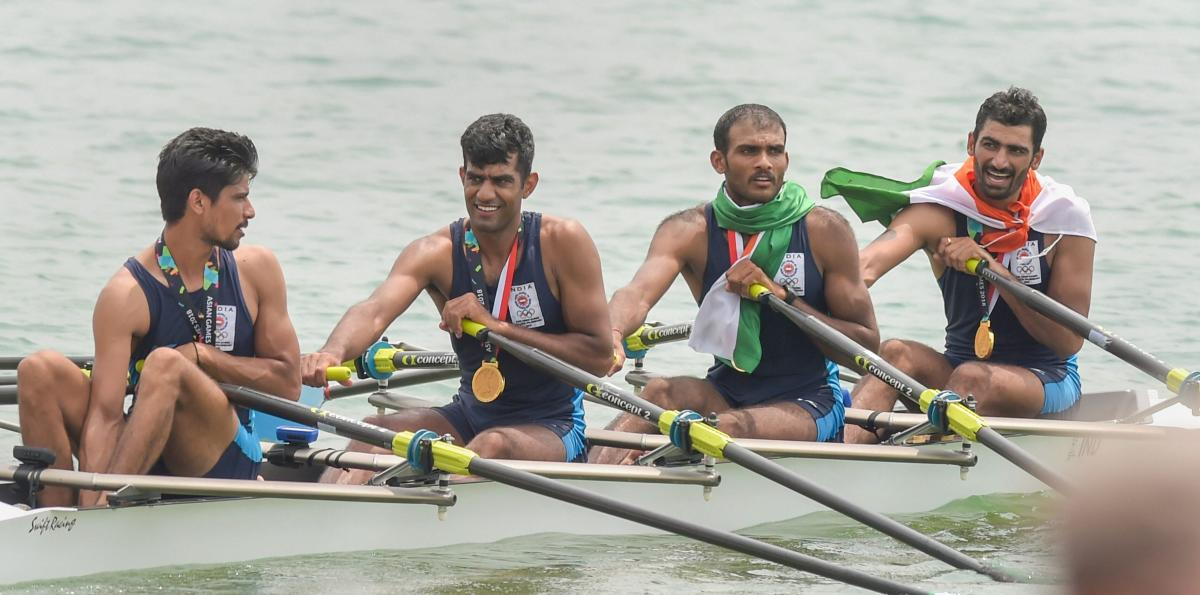 ECSTATIC: Sawarn Singh, Bhokanal Dattu, Om Prakash and Sukhmeet Singh (from left) celebrate after winning the quadruple sculls gold at the Asian Games on Friday. PTI
