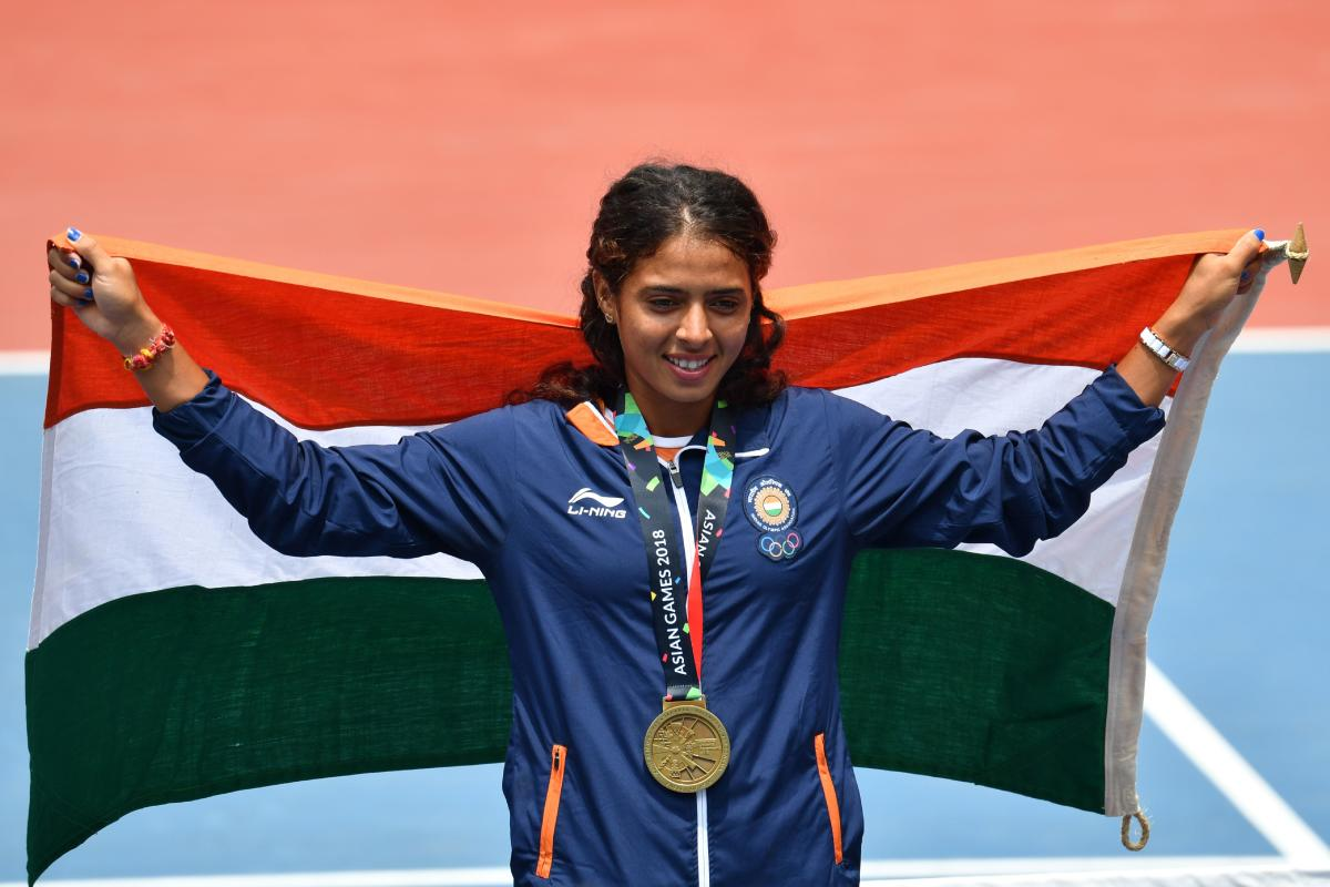 Indian tennis player Ankita Raina celebrates after winning bronze in the women's singles event. AFP
