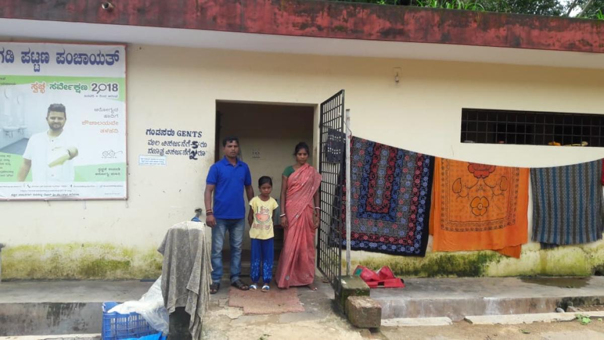 A civic worker's family has made a public toilet their home.
