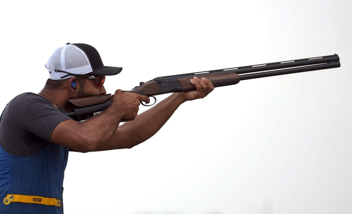 Indian shooter Angad Vir Singh Bajwa competes for qualification in the Skeet Men event at the 18th Asian Games Jakarta Palembang 2018, in Indonesia on Sunday, Aug 26, 2018. (PTI Photo)