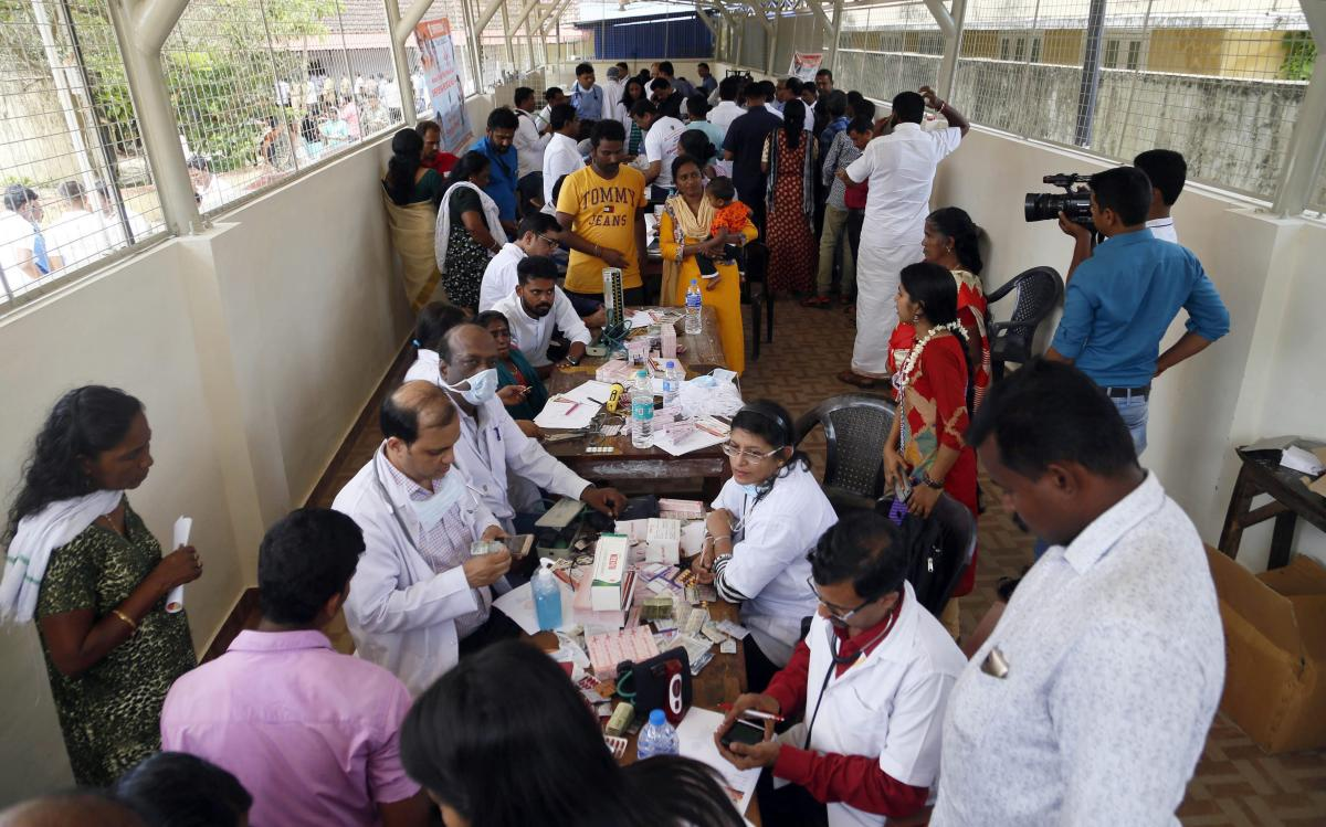 Doctors monitor the health of flood victims inside SDVP school classroom converted into a temporary relief camp, in Alleppey on Sunday. PTI