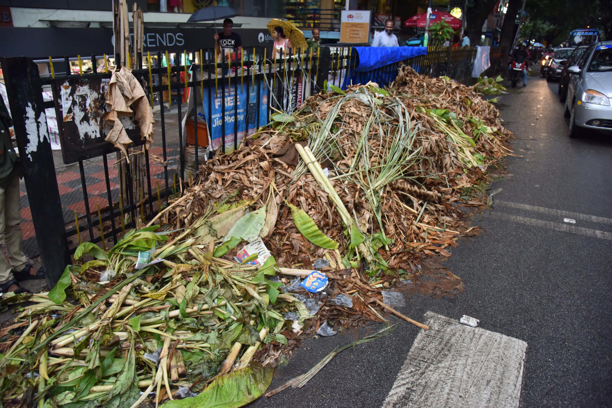 An uncleared garbage pile after Varamahalakshmi festival on Malleswara 8th Cross on Sunday. DH PHOTO/Janardhan B K