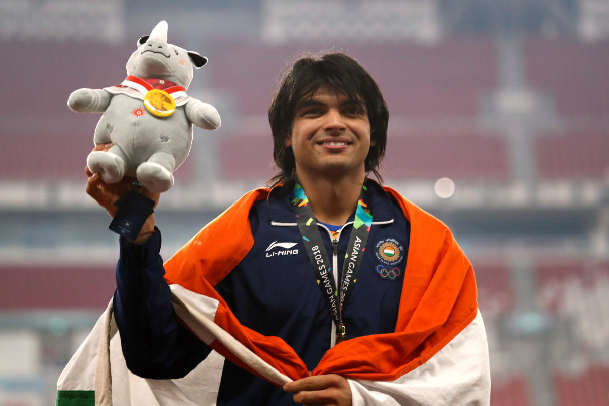 Neeraj Chopra flashes a smile after receiving the javelin throw gold at the Asian Games on Monday. REUTERS