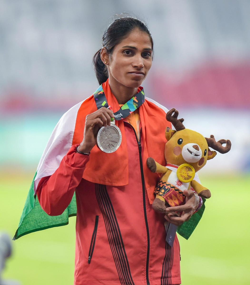 Silver medallist India's Steeplechase athlete Sudha Singh poses for photographs during the 18th Asian Games Jakarta - Palembang 2018, in Jakarta on Monday, Aug 27, 2018. (PTI Photo)