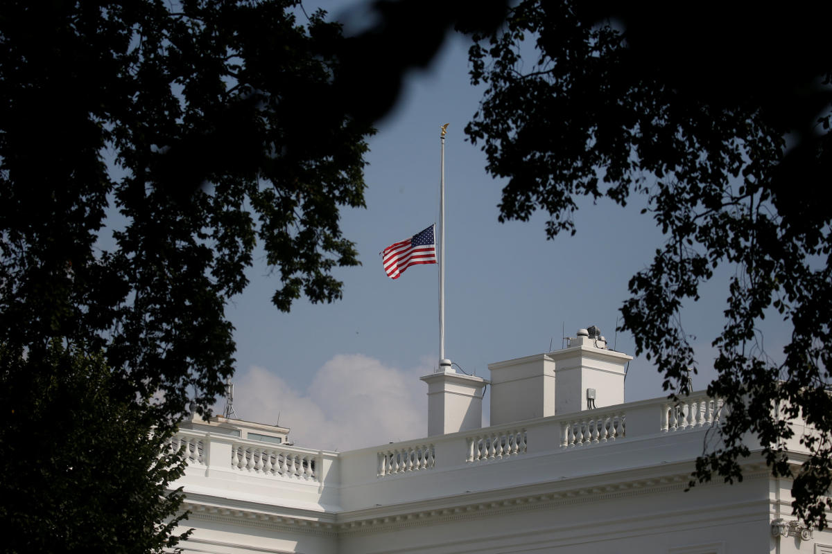 The White House flag is seen after being returned to half-staff in honor of Senator John McCain (R-AZ) after first being lowered on Sunday in his honor, then raised again just after midnight on Monday and then being returned to half-staff Monday afternoon at the White House in Washington, August 27, 2018. (REUTERS)
