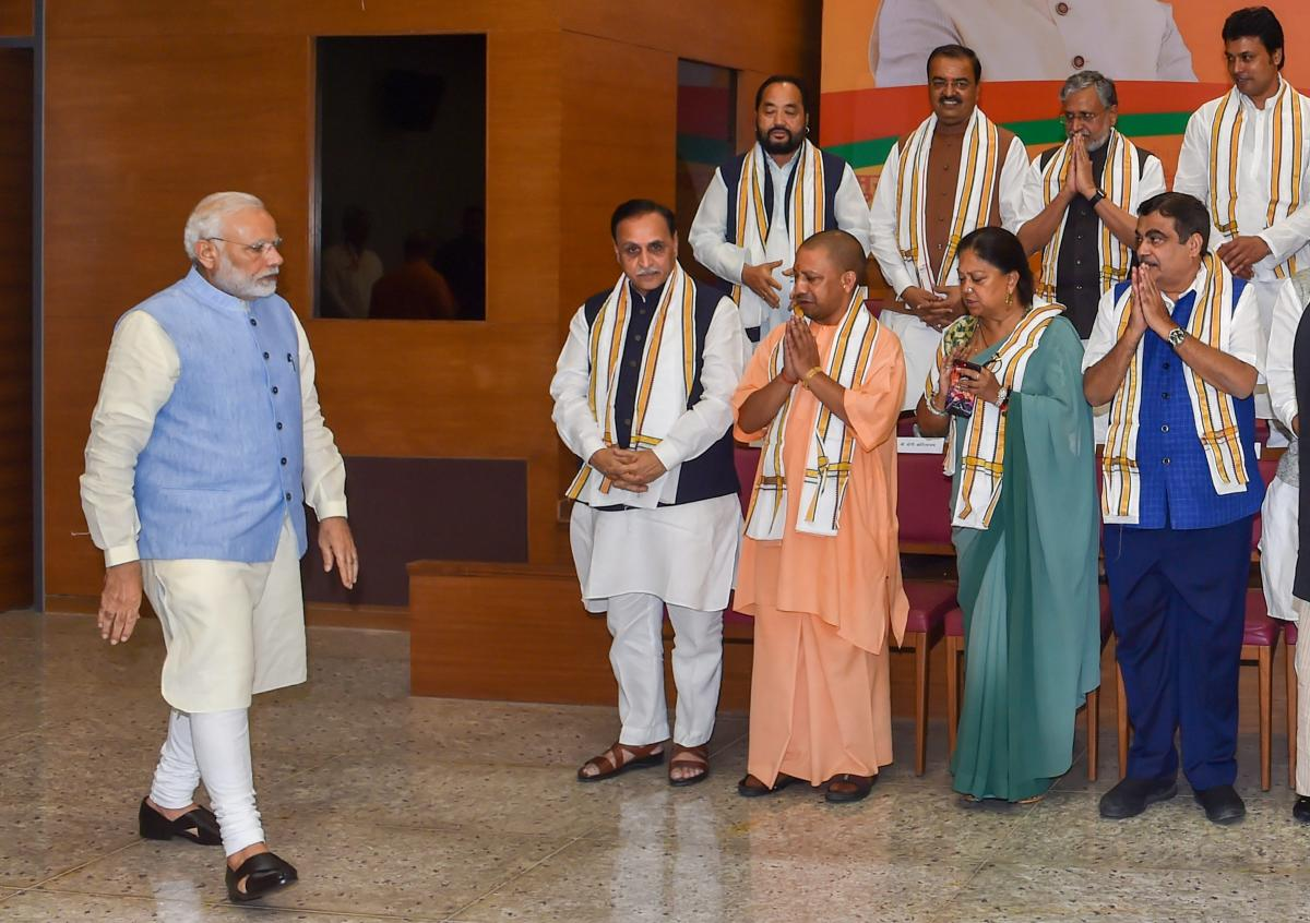 Prime Minister Narendra Modi being greeted on his arrival for a group photo before the start of a day-long meeting of the BJP Chief Ministers' Council in New Delhi on Tuesday. PTI