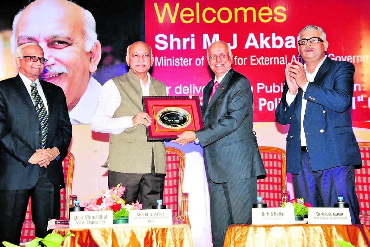 MAHE Pro Chancellor Dr H S Ballal hands over a memento to Union Minister of State for External Affairs M J Akbar at Manipal on Tuesday.
