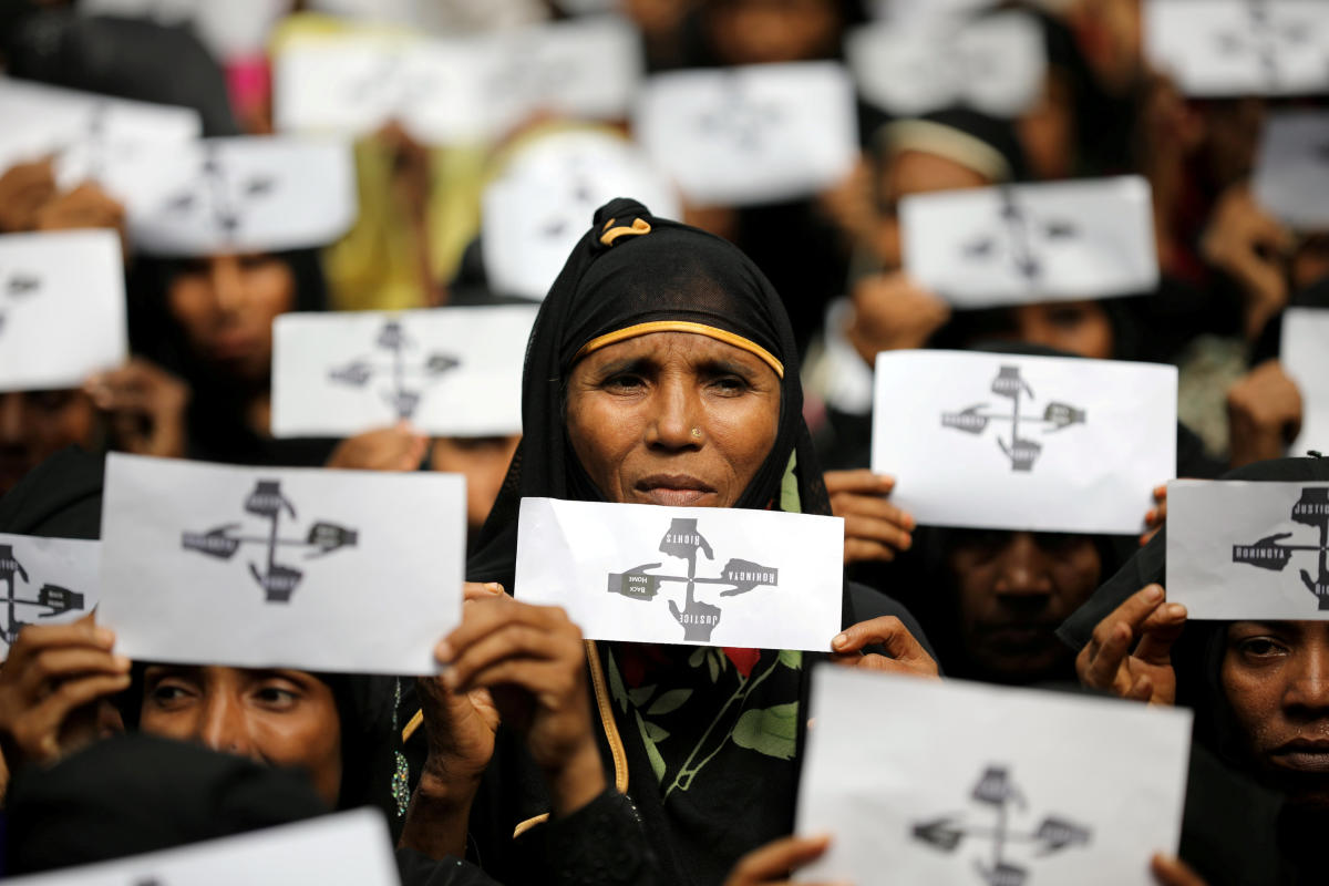 Rohingya refugee women hold placards as they take part in a protest at the Kutupalong refugee camp to mark the one-year anniversary of their exodus in Cox's Bazar, Bangladesh. Reuters File Photo