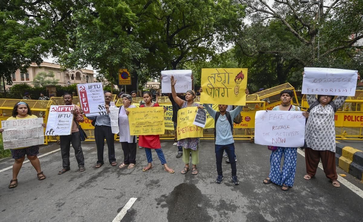 Activists from various organisations stage a protest pertaining to the arrest of five activists in connection with the Bhima-Koregaon protests, in New Delhi. PTI Photo