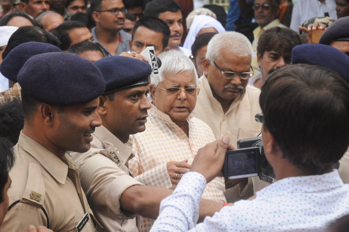 RJD leader and former Bihar chief minister Lalu Prasad Yadav arrives to surrender in connection with multi-crore fodder scam case at special CBI court, in Ranchi on Thursday. (PTI Photo)