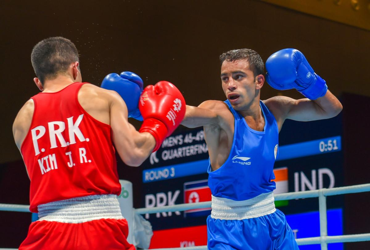 India's Amit Panghal (Blue) and PR Korea's Ryong Jong compete in the Men's Light Fly (46-49kg) Quarterfinal boxing event in the 18th Asian Games 2018 in Jakarta, Indonesia on Wednesday, Aug 29, 2018. PTI Photo