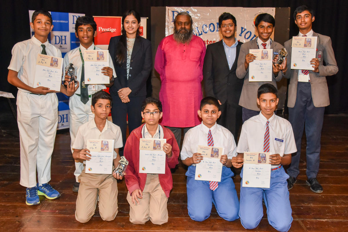 Winners of Senior division inter school quiz computation organised by Deccan Herald in Education (DHiE) at Bal Bhavan in Bengaluru on Thursday. Standing (from left) Shardul Parthasarathy and Hithysh L Kamth of Delhi Public School, Bengaluru South (First p